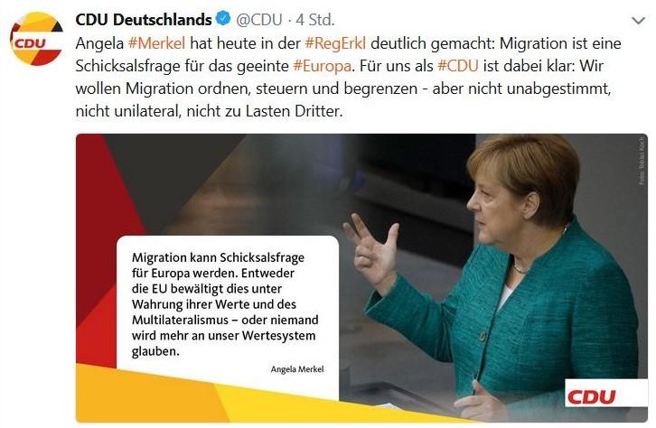 """Angela Merkel im grünen Blazer im Deutschen Bundestag: Migration kann Schicksalsfrage für Europa werden""""."""