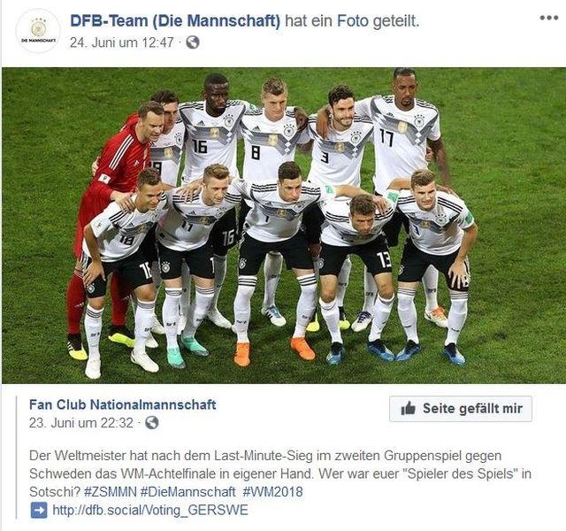 Die deutsche Nationalelf hat sich für die Medien aufgestellt. Manuel Neuer in rot, die Feldspieler in Weiß-Schwarz.