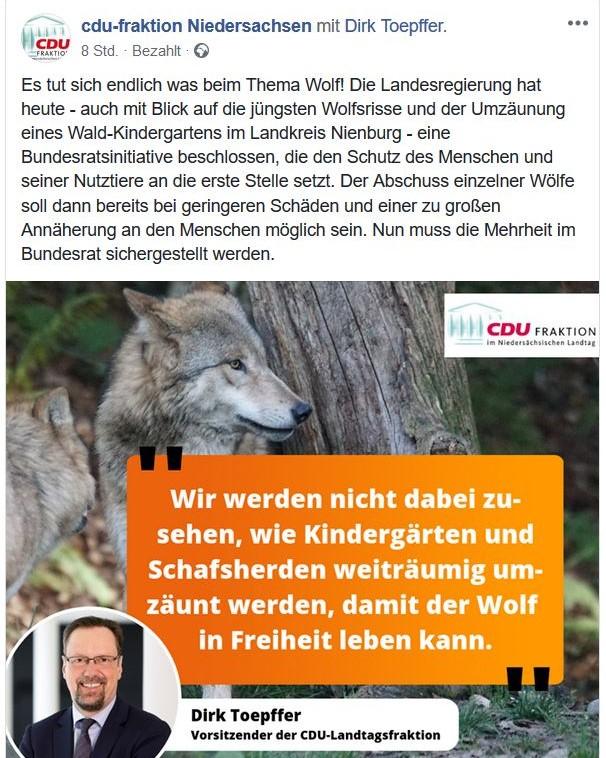 """Facebook-Post mit einem Wolf und einem kleinen Foto des CDU-Fraktionsvorsitzenden und dem Text """"Wir werden nicht dabei zusehen, wie Kindergärten und Schafsherden weiträumig umzäunt werden, damit der Wolf in Freiheit leben kann""""."""