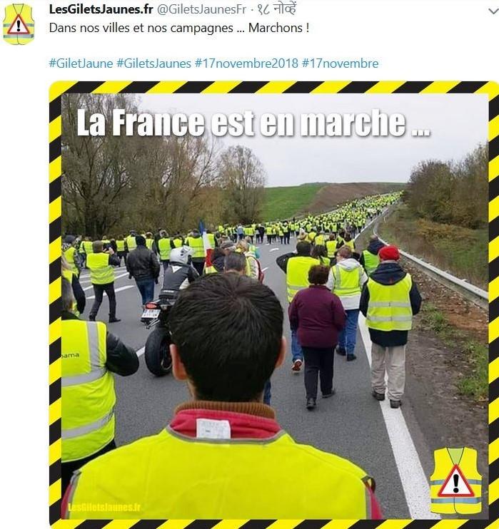 Franzosen mit gelben Warnwesten protestieren gegen steigende Spritpreise und die Regierung Macron mit dem Slogan 'La France est on marche'.