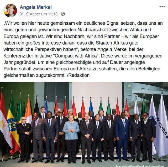 Angela Merkel umgeben von politischen Führern aus Afrika, im Hintergrund die entsprechenden Flaggen.