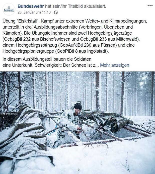 Soldaten der Bundeswehr im verschneiten Wald bei einer Winterübung.