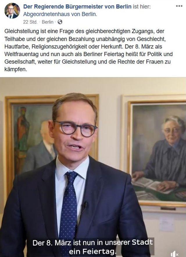 Michael Müller mit Anzug und Krawatte.