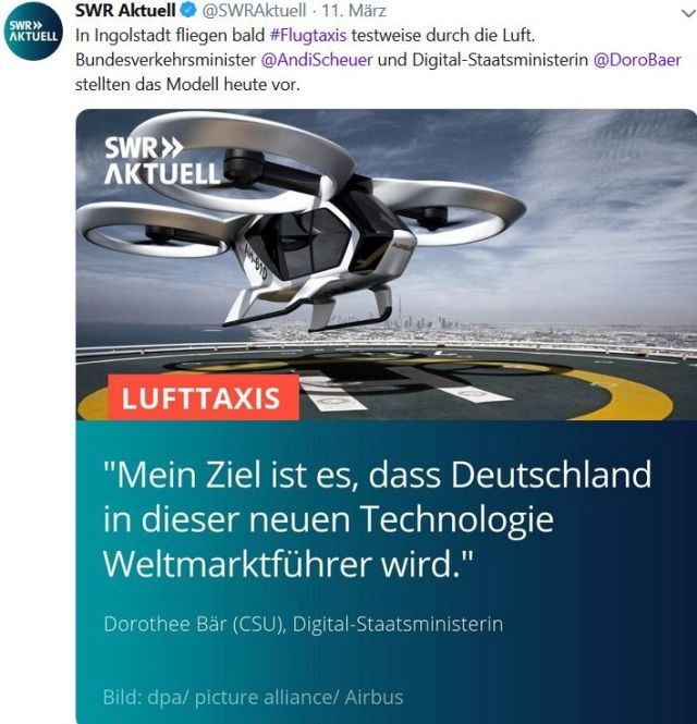 """Modell eines Flugtaxis mit dem Satz von Dorothee Bär: """"""""Mein Ziel ist es, dass Deutschland in dieser Technologie Weltmarktführer wird""""."""