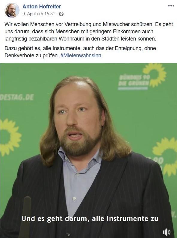 Anton Hofreiter mit Bart und langen braunen Haaren, Sakko und Hemd.