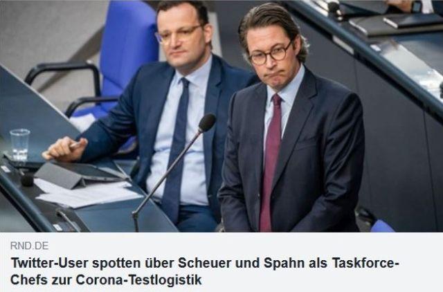 Andreas Scheuer am Rednerpult im Bundestag mit betretenem Gesicht, daneben sitzend auf der Regierungsbank Jens Spahn.